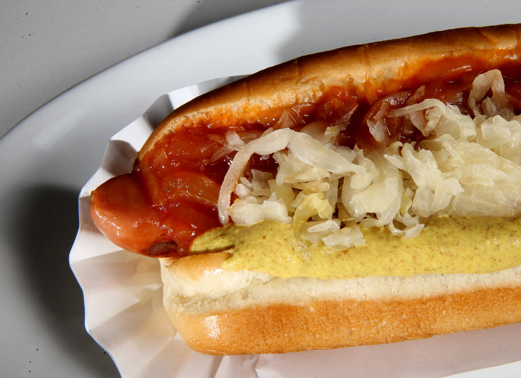 The Empire State Dog grilled frank, onions in red sauce, kraut and spicy mustard at Haute Doggery at LINQ Promenade in Las Vegas Friday, June 29, 2018. K.M. Cannon Las Vegas Review-Journal @KMCann ...