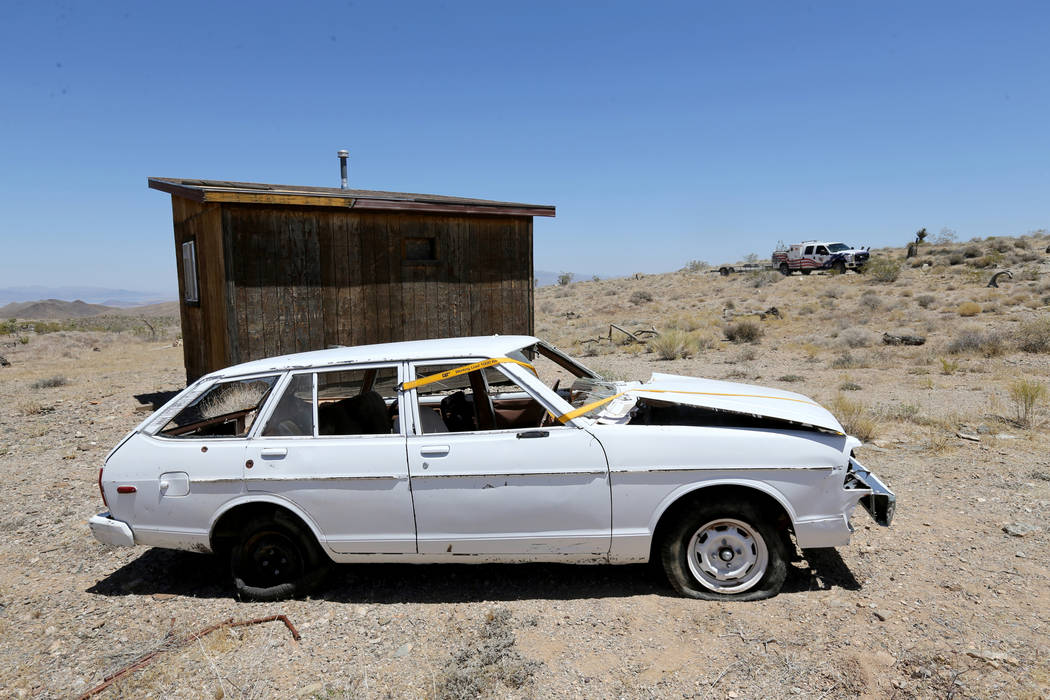 David Nehrbass, owner of Motor Sports Safety Solutions, rear, pulls up to a car that belonged to the late Las Vegas Showboat casino blackjack dealer Mark Blackburn near White Hills, Ariz. Monday, ...