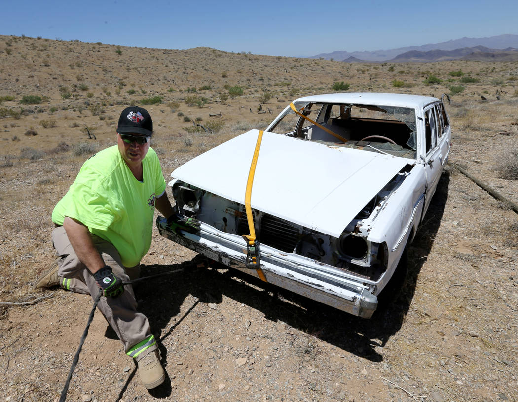 David Nehrbass, owner of Motor Sports Safety Solutions prepares to recover a car that belonged to the late Las Vegas Showboat casino blackjack dealer Mark Blackburn near White Hills, Ariz. Monday, ...