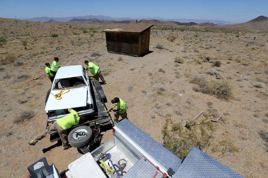 Motor Sports Safety Solutions team members recover a car that belonged to the late Las Vegas Showboat casino blackjack dealer Mark Blackburn near White Hills, Ariz. Monday, June 4, 2018. The 1980 ...