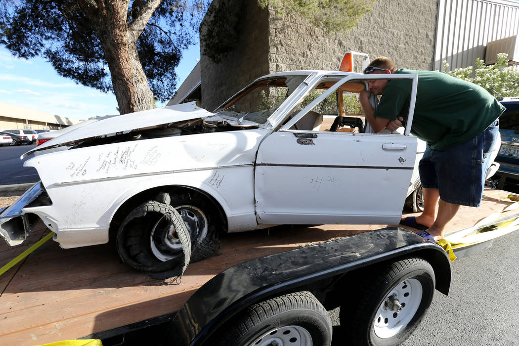 Michael Wiley Blackburn of Hartford, Wis. hugs a car that belonged to his father, the late Las Vegas Showboat casino blackjack dealer Mark Blackburn, at Chick With A Wrench shop in Las Vegas Frida ...