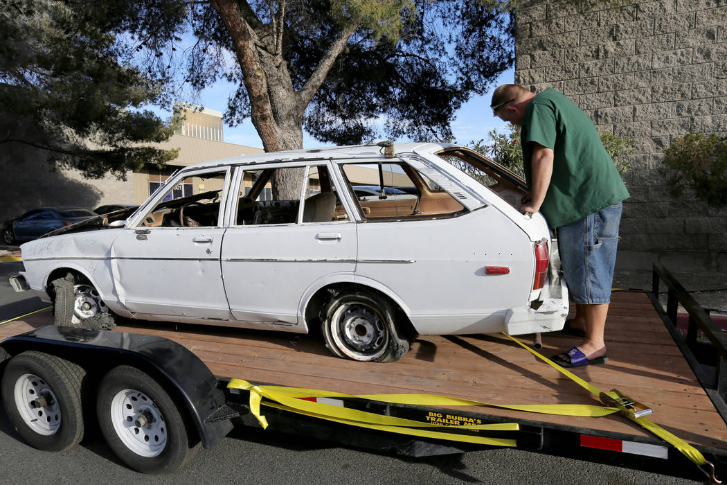 Michael Wiley Blackburn of Hartford, Wis. reacts to seeing a car that belonged to his father, the late Las Vegas Showboat casino blackjack dealer Mark Blackburn, at Chick With A Wrench shop in Las ...