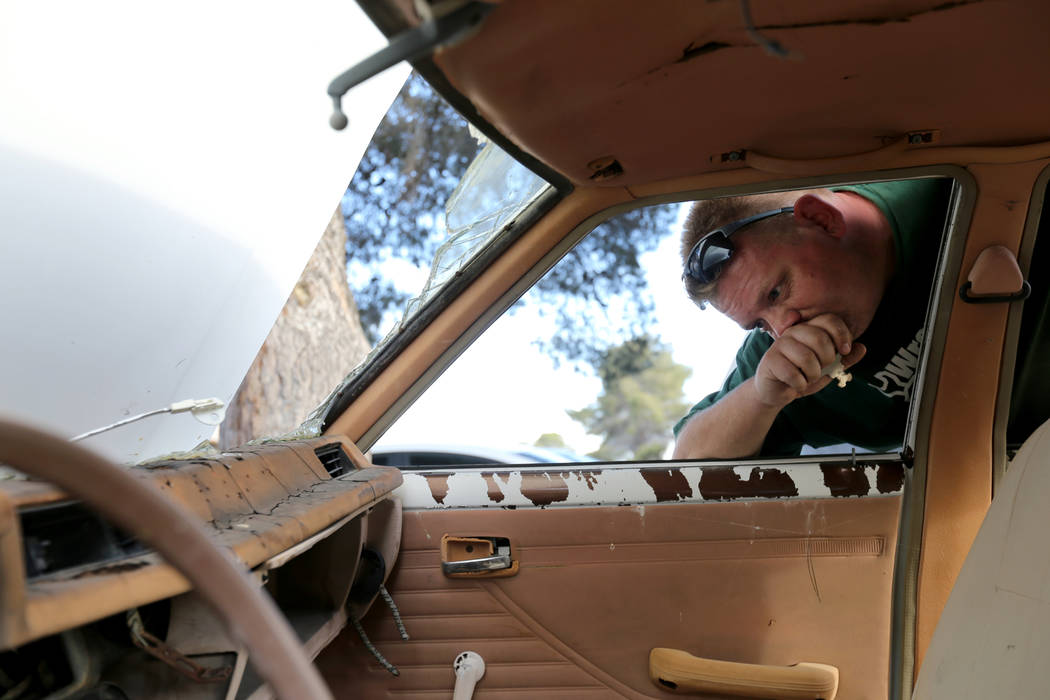 Michael Wiley Blackburn of Hartford, Wis. reacts to seeing a car that belonged to his father, t ...