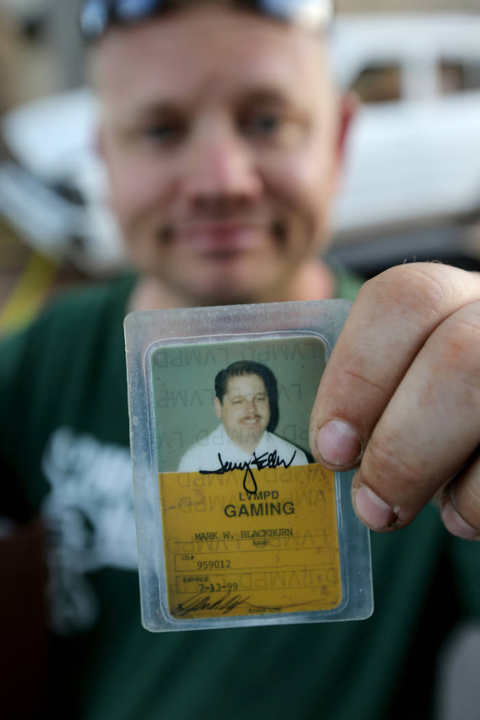 Michael Wiley Blackburn of Hartford, Wis. shows a work card that that belonged to his father, the late Las Vegas Showboat casino blackjack dealer Mark Blackburn, at Chick With A Wrench shop in Las ...