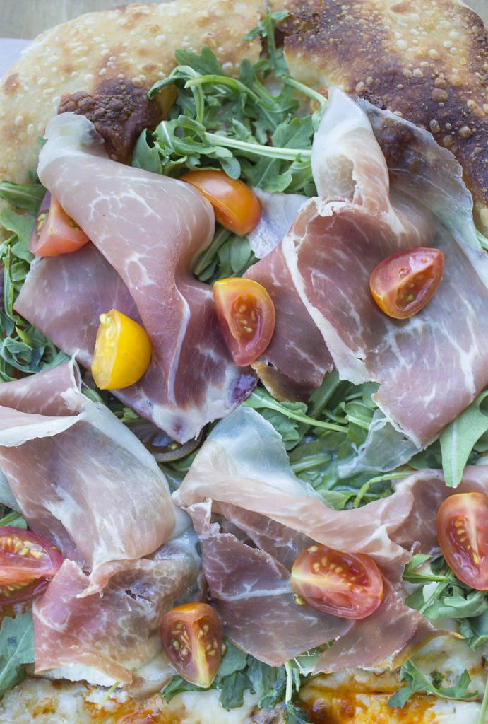 Vegas Meets Italy pizza with scamorza, mozzarella, ricotta, pistachio, dates, heirloom tomatoes, arugula, prosciutto and date cream at Pizzeria Monzœ on Monday, July 2, 2018, in Las Vegas. B ...