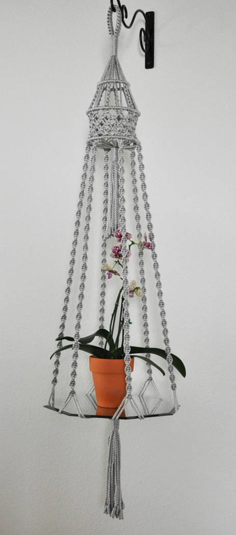 Macrame Market This hand-crafted macrame plant hanger is available through Etsy's Macrame Market.