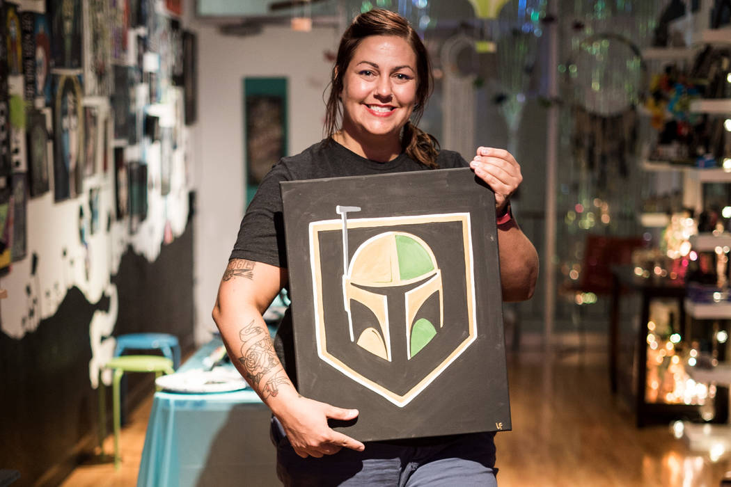 Leslie Ann Farrell, art instructor and owner of The Bubblegum Gallery, holds up her work at the Boba Fett Golden Knight Paint Class in Las Vegas, Friday, June 29, 2018. (Marcus Villagran/Las Vegas ...