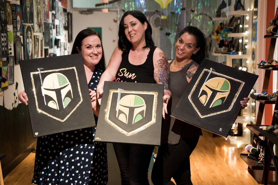 From left, friends Tammy Wilkins, Fiona Fraias and Jasmine Turner attend the Boba Fett Golden Knight Paint Class at The Bubblegum Gallery in Las Vegas, Friday, June 29, 2018. (Marcus Villagran/Las ...