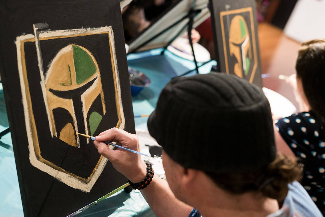 Locals attend the Boba Fett Golden Knight Paint Class at The Bubblegum Gallery in Las Vegas, Friday, June 29, 2018. (Marcus Villagran/Las Vegas Review-Journal) @brokejournalist