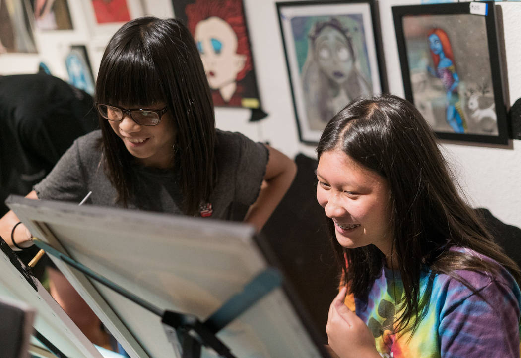 Sisters Ava Patag, left, 11, and Ria Patag, right, 15, attend the Boba Fett Golden Knight Paint Class at The Bubblegum Gallery in Las Vegas, Friday, June 29, 2018. (Marcus Villagran/Las Vegas Revi ...