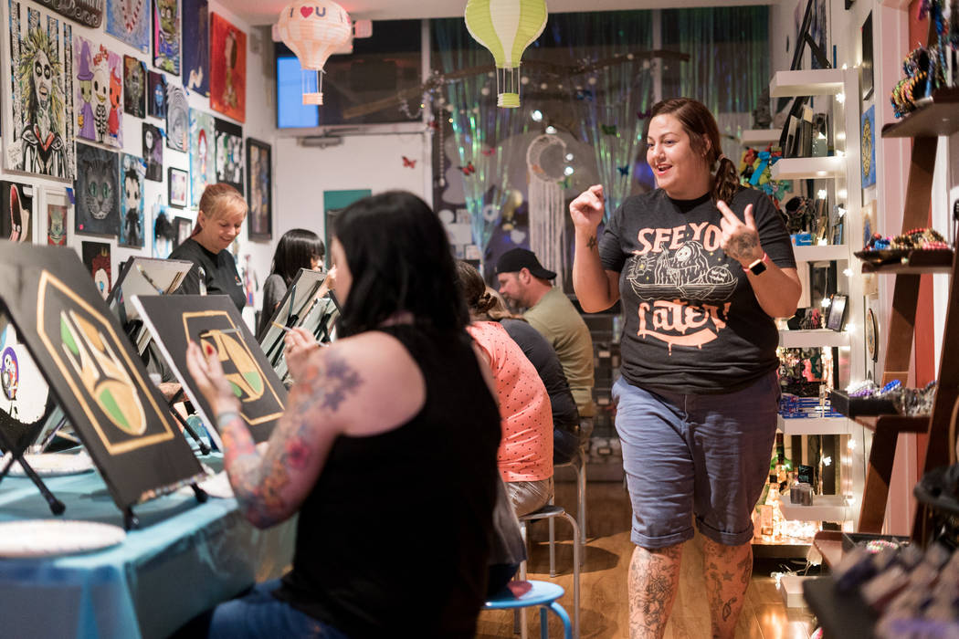 Leslie Ann Farrell, right, art instructor and owner of The Bubblegum Gallery, provides step-by-step instruction at the Boba Fett Golden Knight Paint Class in Las Vegas, Friday, June 29, 2018. ...