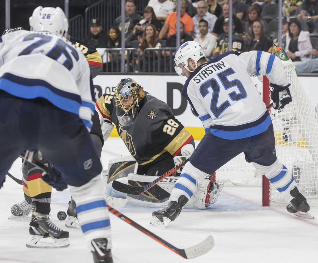 Golden Knights goaltender Marc-Andre Fleury (29) makes a save against Jets center Paul Stastny (25) in the second period during game four of Las Vegas' NHL Western Conference Finals matchup with W ...