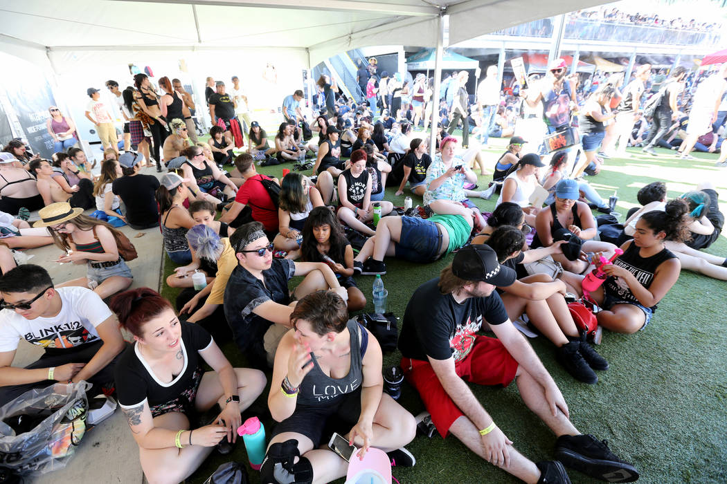 Fans stay cool during Warped Tour at Downtown Las Vegas Events Center on Friday, June 29, 2018. K.M. Cannon Las Vegas Review-Journal @KMCannonPhoto