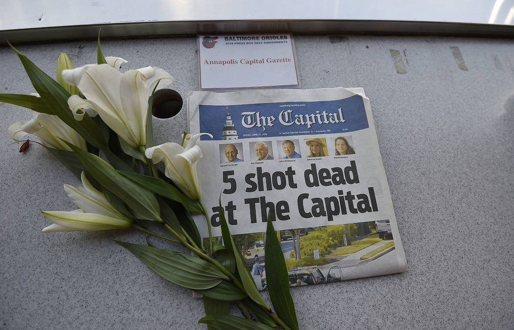 A memorial for Capital Gazette sports writer John McNamara is displayed at a seat in the press box before a baseball game between the Baltimore Orioles and the Los Angeles Angels, Friday, June 29, ...