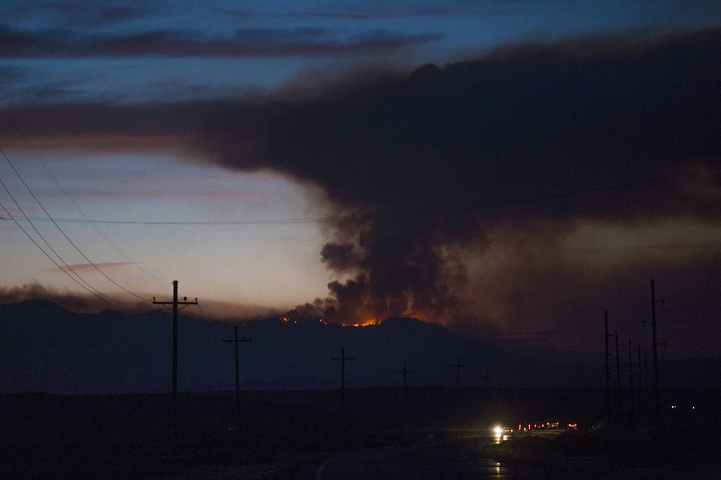 The West Valley Fire seen from 59 North in southern Utah, Friday, June 29, 2018. The fire grew an estimated 4,700 acres Thursday to reach 7,200 acres in total, and officials say the blaze was huma ...