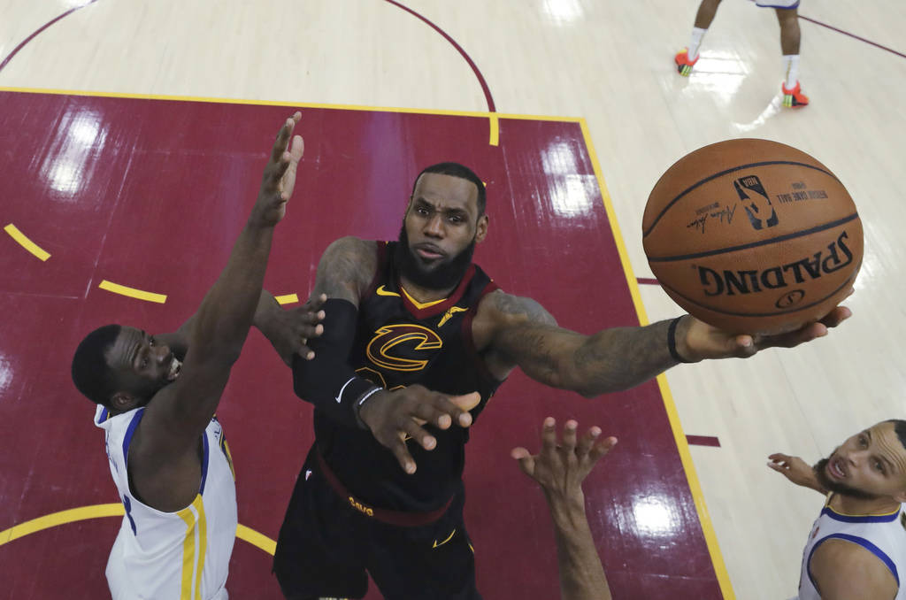 Cleveland Cavaliers' LeBron James shoots against Golden State Warriors' Draymond Green during the first half of Game 3 of basketball's NBA Finals, in Cleveland in June 2018. (Gregory Shamus/Pool P ...