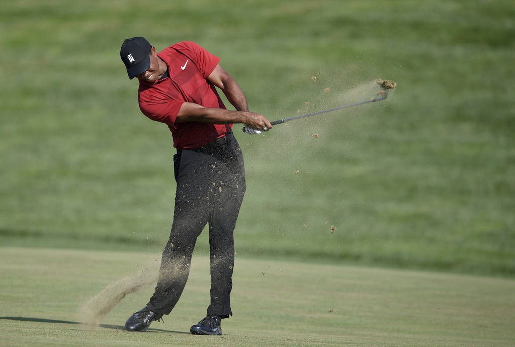Tiger Woods hits from the 16th fairway during the final round of the Quicken Loans National golf tournament, Sunday, July 1, 2018, in Potomac, Md. (AP Photo/Nick Wass)