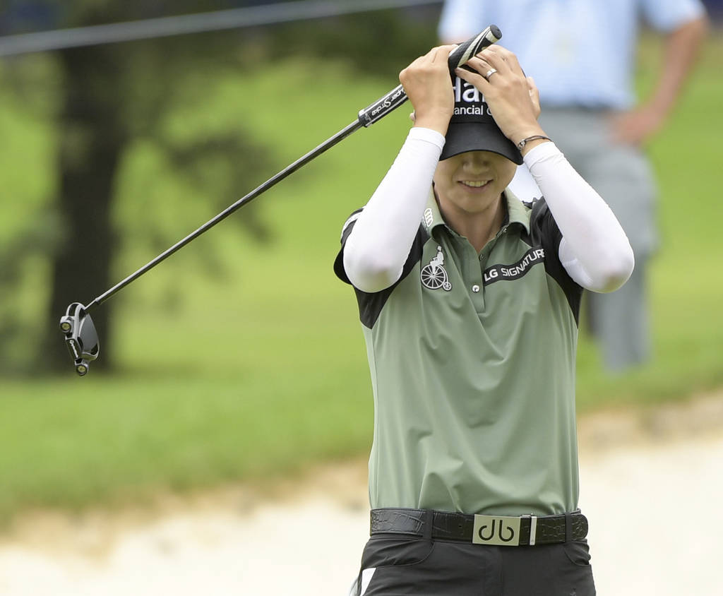 Sung Hyun Park, of South Korea, celebrates on the 16th green after defeating So Yeon Ryu, also of South Korea, during the second playoff hole during the final round of the KPMG Women's PGA Champio ...