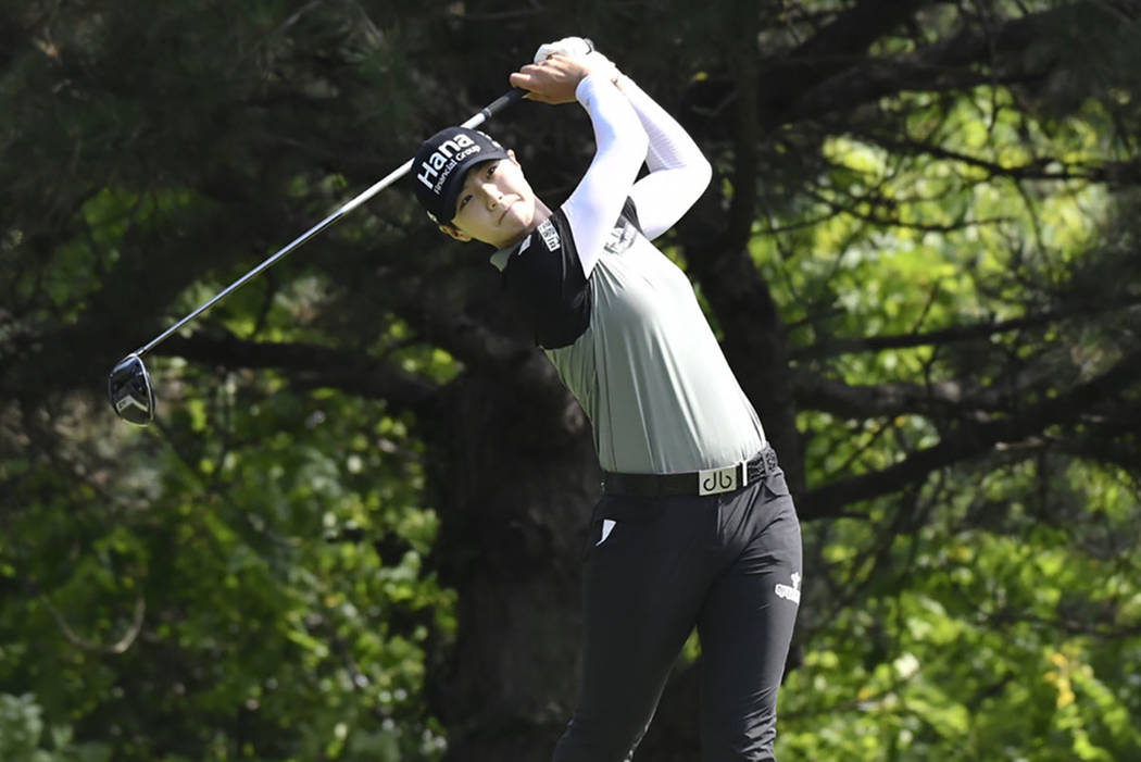 Sung Hyun Park, of South Korea, watches her tee shot on the second hole during the final round of the KPMG Women's PGA Championship golf tournament at Kemper Lakes Golf Club in Kildeer, Ill., Sund ...