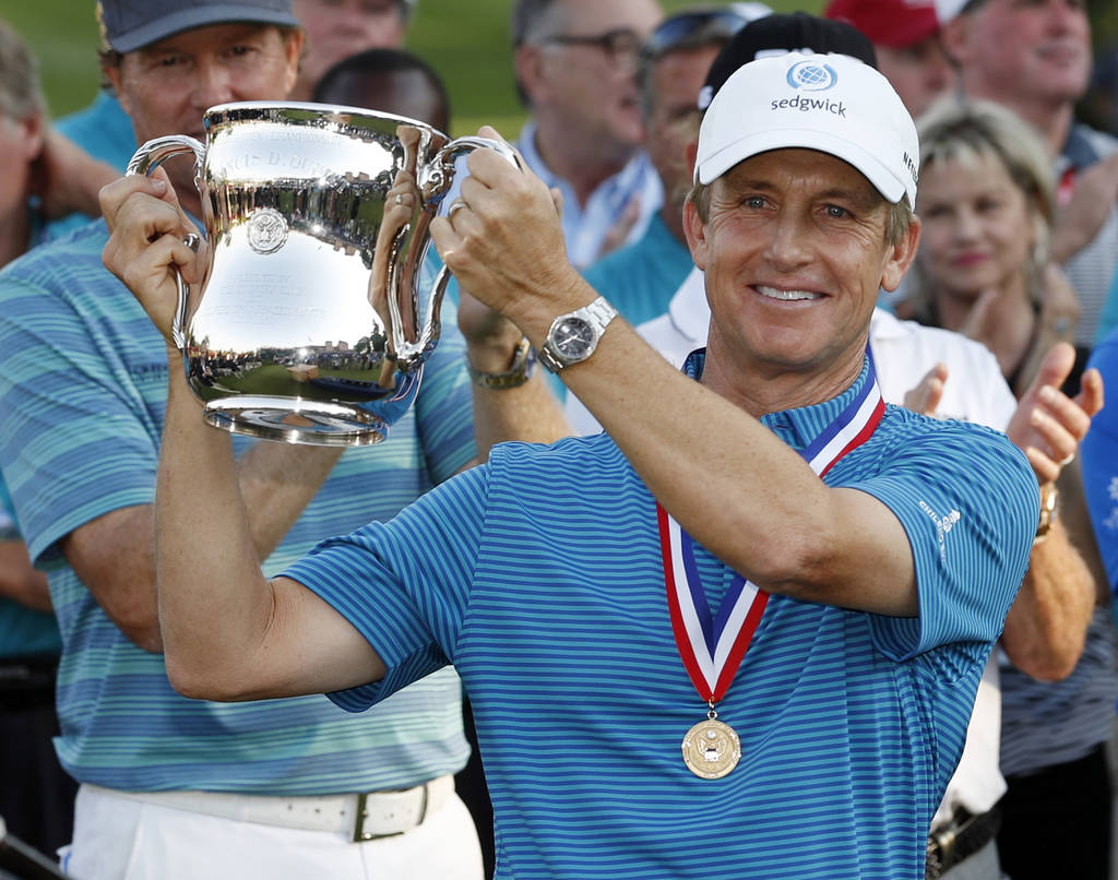 David Toms holds up the trophy after winning the U.S. Senior Open golf tournament at The Broadmoor, Sunday, July 1, 2018, in Colorado Springs, Colo. (AP Photo/David Zalubowski)