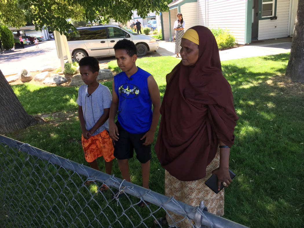 Fathi Mahamoud, 11, left, Esrom Habte, 12, center, and Thado Aip describe the Saturday night attack that left nine fellow residents of their Boise, Idaho, apartment complex with stabbing injuries, ...