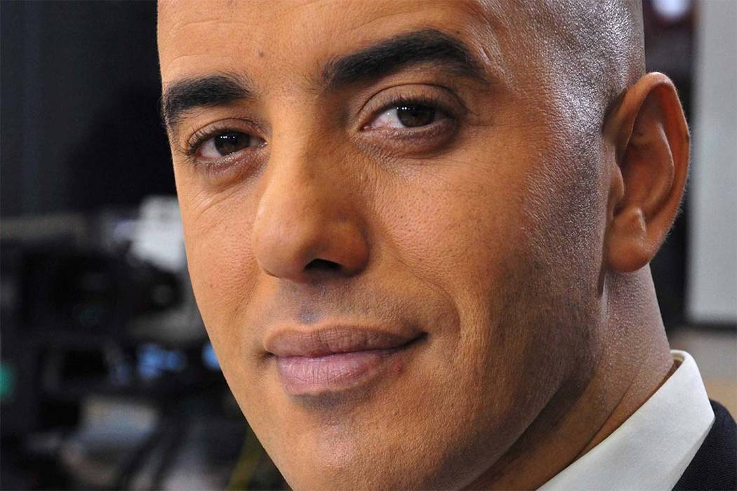In this photo dated Nov. 22, 2010, notorious French criminal Redoine Faid poses prior to an interview with French all-news TV channel, LCI, as he was promoting his book, in Boulogne-Billancourt, o ...