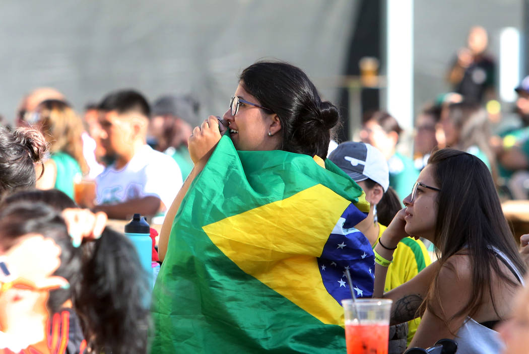 A Brazil fan Caroline Ramon of Rio De Janeiro, Brazil, reacts as she watches a match between Mexico and Brazil during a watch party of the World Cup at the Downtown Las Vegas Event Center on Monda ...