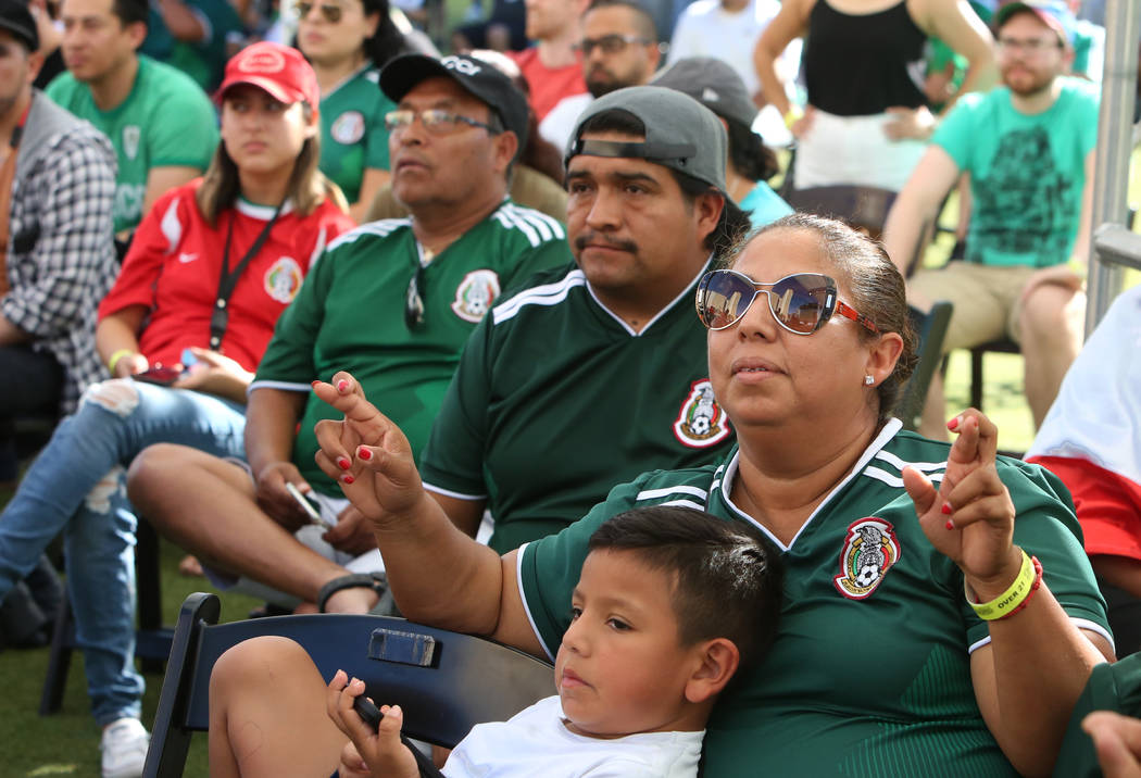 Mexico fans, including Isela Velarguez, center, watch a match between Mexico and Brazil during a watch party of the World Cup at the Downtown Las Vegas Event Center on Monday, July 02, 2018. Brazi ...