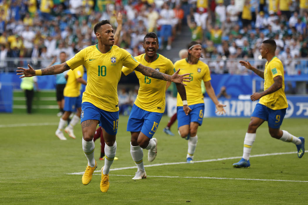 Brazil's Neymar, left, celebrates after scoring his side's opening goal during the round of 16 match between Brazil and Mexico at the 2018 soccer World Cup in the Samara Arena, in Samara, Russia, ...