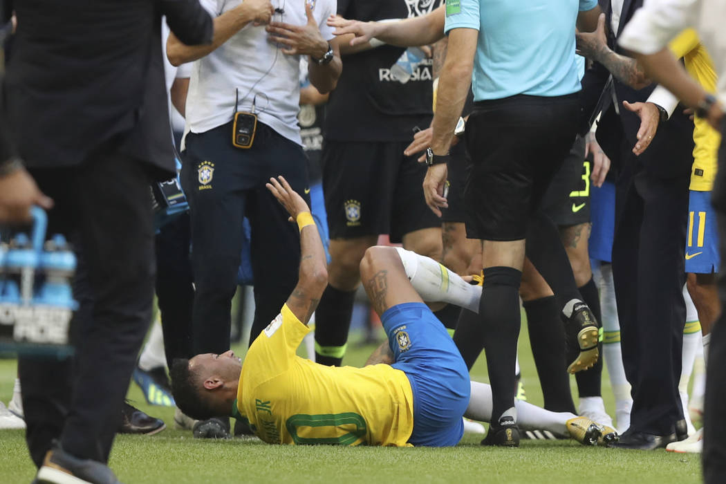 Brazil's Neymar gestures on the ground during the round of 16 match between Brazil and Mexico at the 2018 soccer World Cup in the Samara Arena, in Samara, Russia, Monday, July 2, 2018. (AP Photo/T ...