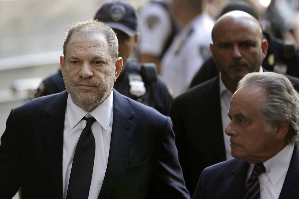 Harvey Weinstein arrives to court in New York, June 5, 2018. Weinstein has been accused of a forcible sex act by a third woman in an updated indictment. District Attorney Cyrus R. Vance Jr. announ ...