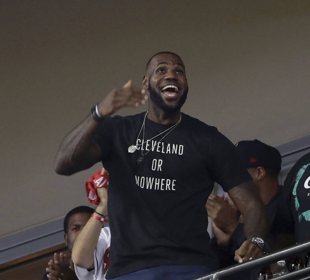 In this Nov. 2, 2016, file photo, LeBron James watches during the eighth inning of Game 7 of the baseball World Series between the Cleveland Indians and the Chicago Cubs in Cleveland. (AP Photo/Ma ...