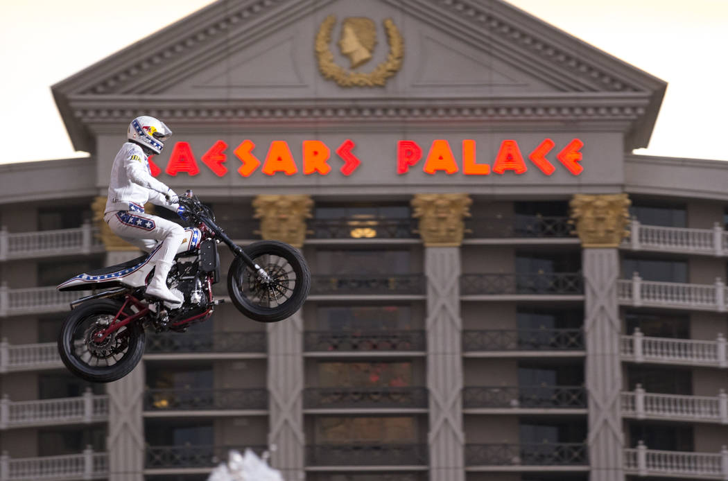 """Travis Pastrana jumps over the fountains at Caesars Palace on an Indian Scout FTR750 motorcycle during """"Evel Live,"""" a three-hour live tribute show to stuntman Evel Kneivel, in Las Vegas ..."""