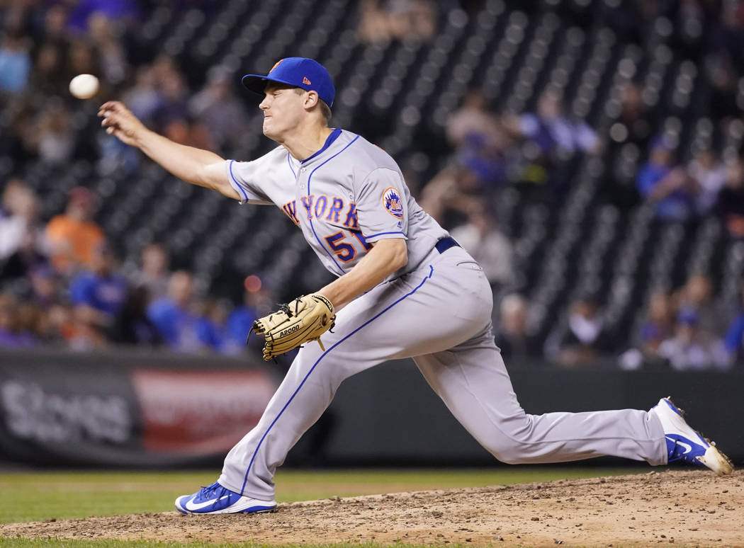 New York Mets relief pitcher Paul Sewald throws against the Colorado Rockies during the ninth inning of a baseball game, Monday, June 18, 2018, in Denver. (AP Photo/Jack Dempsey)