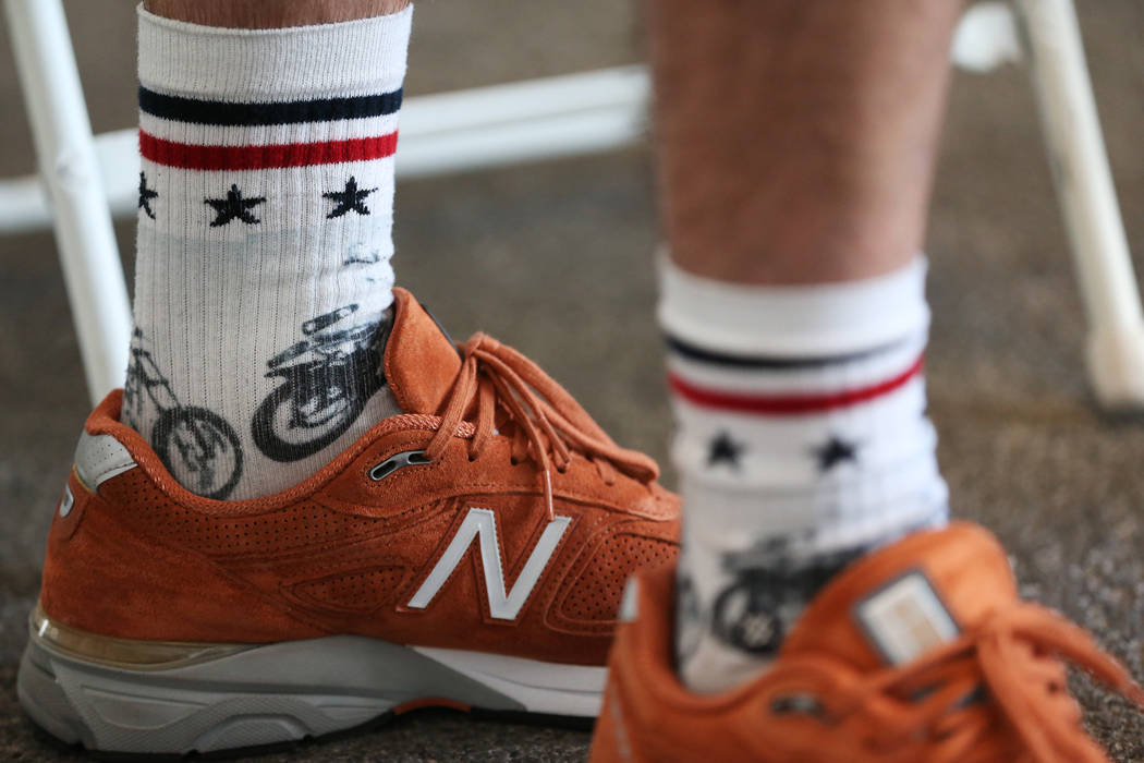 Travis Pastrana, professional motorsports competitor and stunt performer, wears Dare Devil socks, part of the Evel Knievel x Stance collection, during an interview at the Caesars Palace casino-hot ...