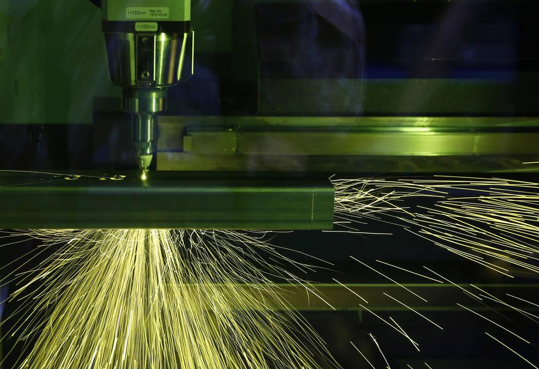 The TruLaser Tube 5000 laser cutting machine cuts out a piece of metal at Precision Tube Laser, LLC, on Wednesday, June 20, 2018, in Las Vegas. Bizuayehu Tesfaye/Las Vegas Review-Journal @bizutesfaye