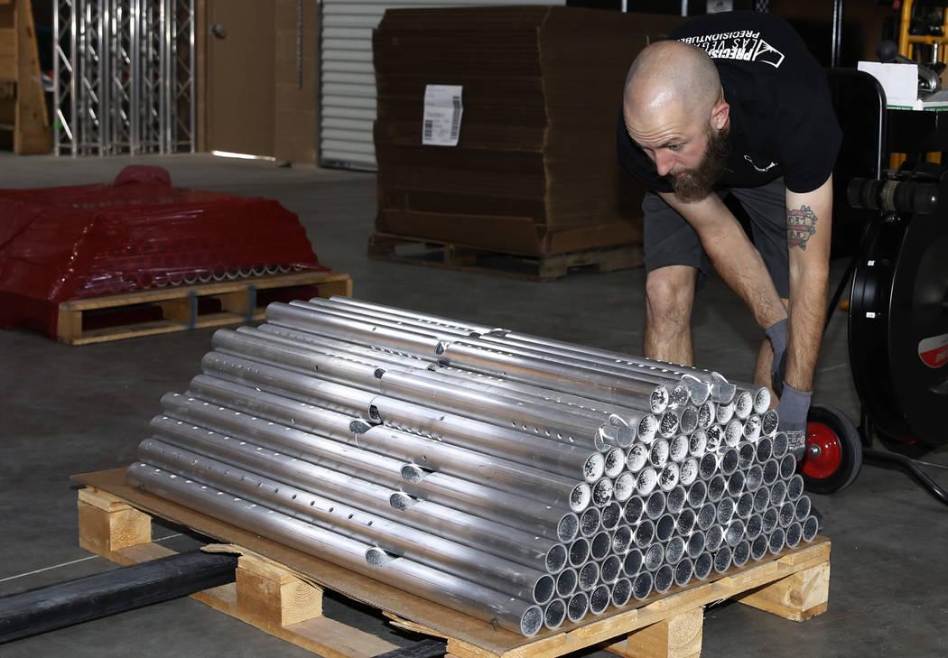 Billy Beddow, general manager at Precision Tube Laser, LLC, stacks cut aluminum pipes onto a pallet on Wednesday, June 20, 2018, in Las Vegas. Bizuayehu Tesfaye/Las Vegas Review-Journal @bizutesfaye