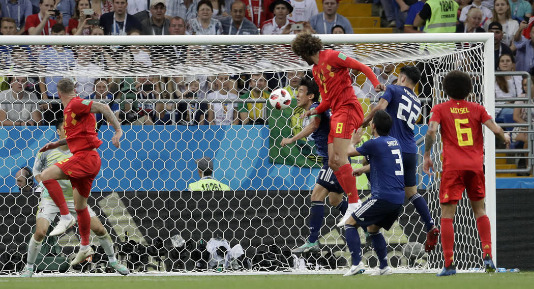 Belgium's Marouane Fellaini scores his side's second goal with his head during the round of 16 match between Belgium and Japan at the 2018 soccer World Cup in the Rostov Arena, in Rostov-on-Don, R ...