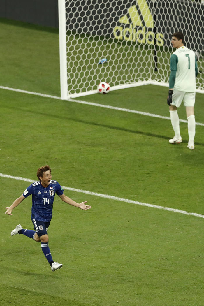 Japan's Takashi Inui, left, celebrates after scoring his second side goal during the round of 16 match between Belgium and Japan at the 2018 soccer World Cup in the Rostov Arena, in Rostov-on-Don, ...