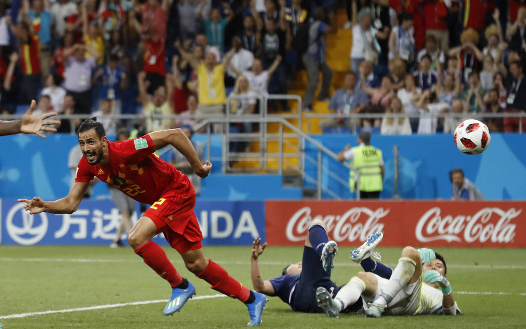 Belgium's Nacer Chadli, left, celebrates with teammates after scoring his third side's goal during the round of 16 match between Belgium and Japan at the 2018 soccer World Cup in the Rostov Arena, ...