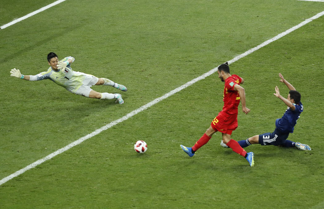 Belgium's Nacer Chadli, center, scores his third side goal during the round of 16 match between Belgium and Japan at the 2018 soccer World Cup in the Rostov Arena, in Rostov-on-Don, Russia, Monday ...