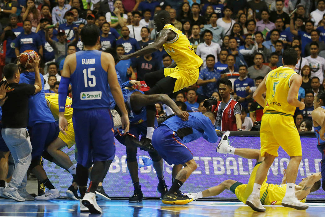 The Philippines and Australian basketball players react, during the FIBA World Cup Qualifiers Monday, July 2, 2018 at the Philippine Arena in suburban Bocaue township, Bulacan province north of Ma ...