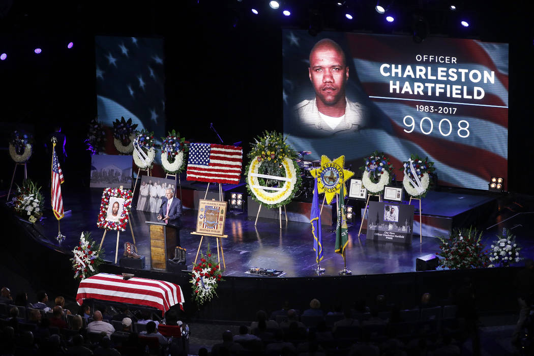 Pastor Mike Ellingsen speaks during a funeral for Las Vegas police officer Charleston Hartfield, Friday, Oct. 20, 2017, in Henderson, Nev. Hartfield was killed by a gunman shooting from a hotel in ...