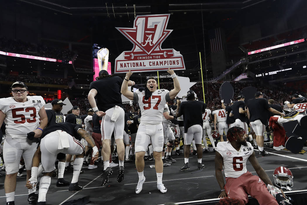 Alabama's Joseph Bulovas celebrates after overtime of the NCAA college football playoff championship game against Georgia, Monday, Jan. 8, 2018, in Atlanta. Alabama won 26-23. (AP Photo/David J. P ...