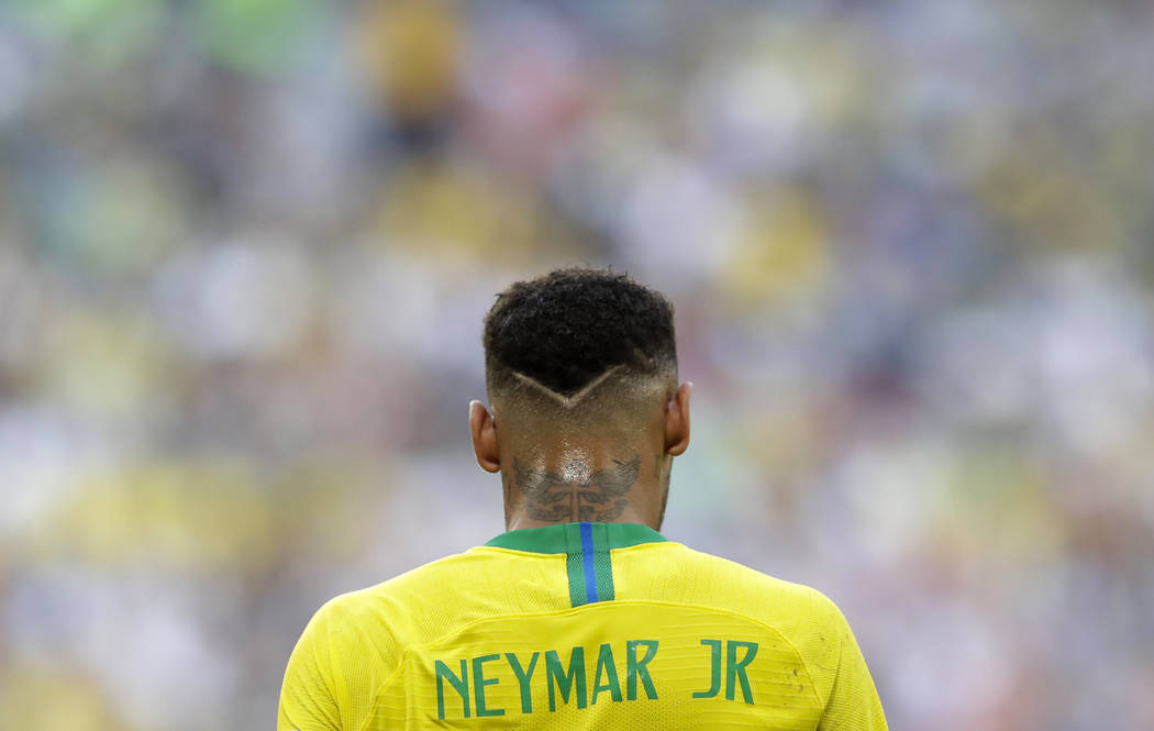 Brazil's Neymar walks on the pitch during the round of 16 match between Brazil and Mexico at the 2018 soccer World Cup in the Samara Arena, in Samara, Russia, Monday, July 2, 2018. (AP Photo/Andre ...