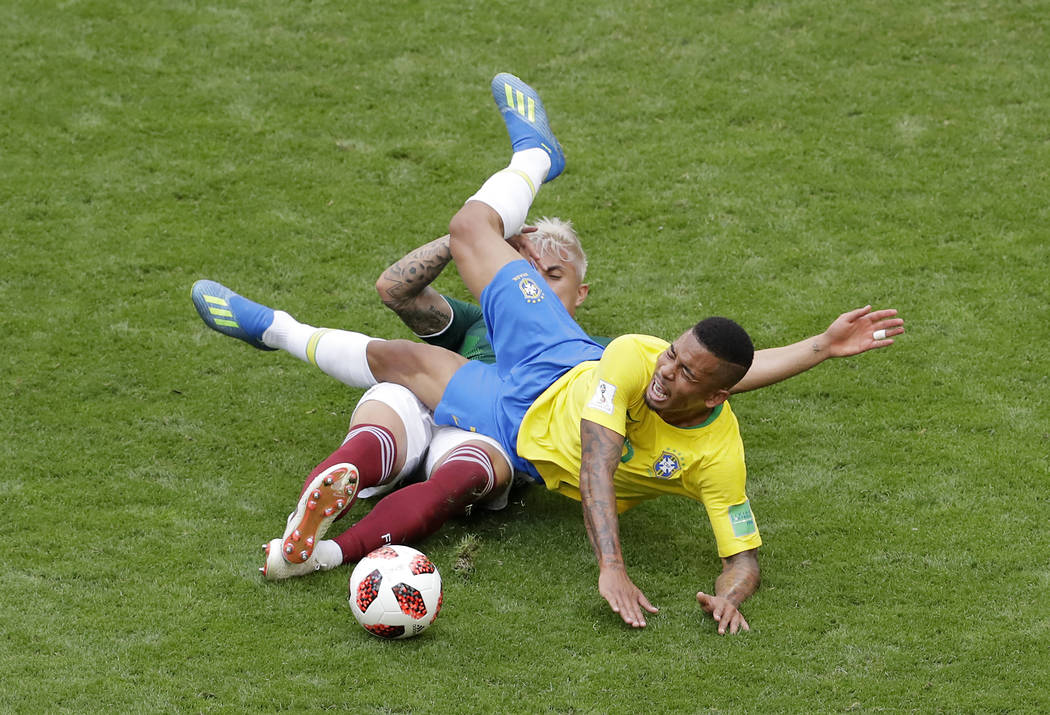 Brazil's Gabriel Jesus, right, challenges for the ball with Mexico's Carlos Salcedo during the round of 16 match between Brazil and Mexico at the 2018 soccer World Cup in the Samara Arena, in Sama ...