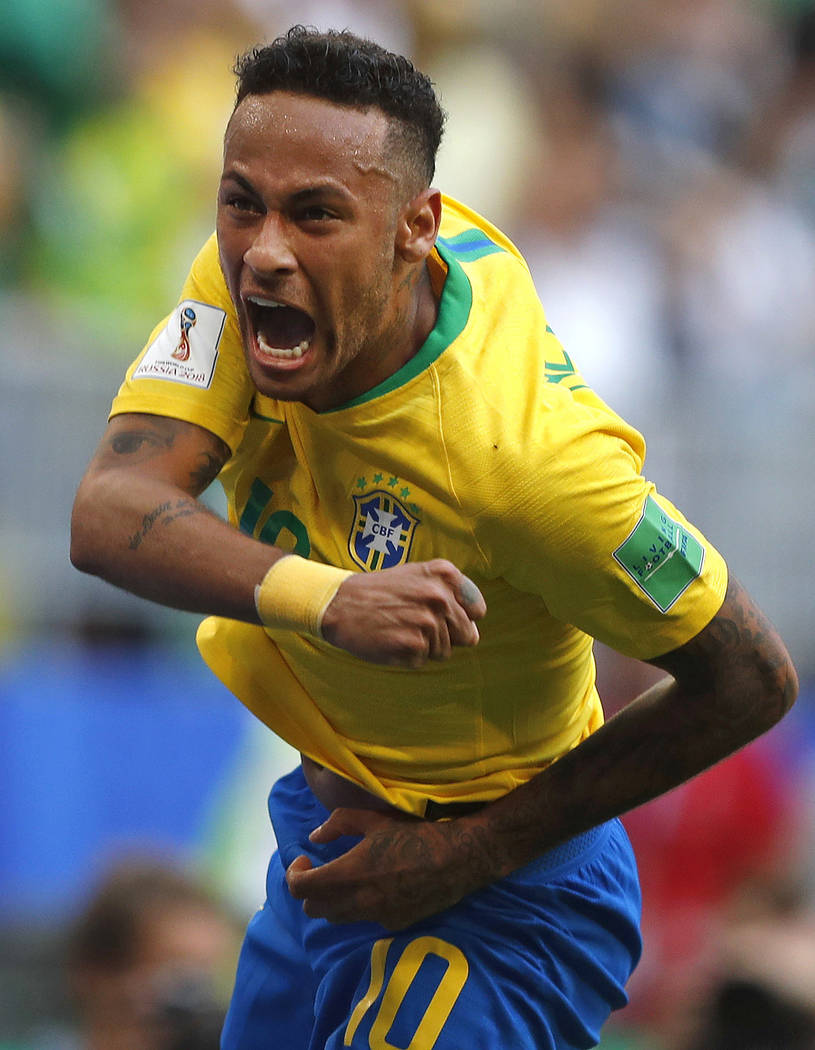 Brazil's Neymar celebrates after scoring his side's opening goal during the round of 16 match between Brazil and Mexico at the 2018 soccer World Cup in the Samara Arena, in Samara, Russia, Monday, ...