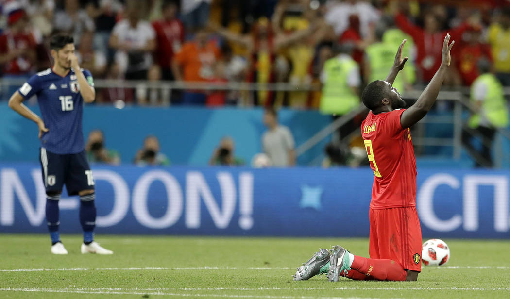 Belgium's Romelu Lukaku, right, prays after winning the round of 16 match between Belgium and Japan at the 2018 soccer World Cup in the Rostov Arena, in Rostov-on-Don, Russia, Monday, July 2, 2018 ...