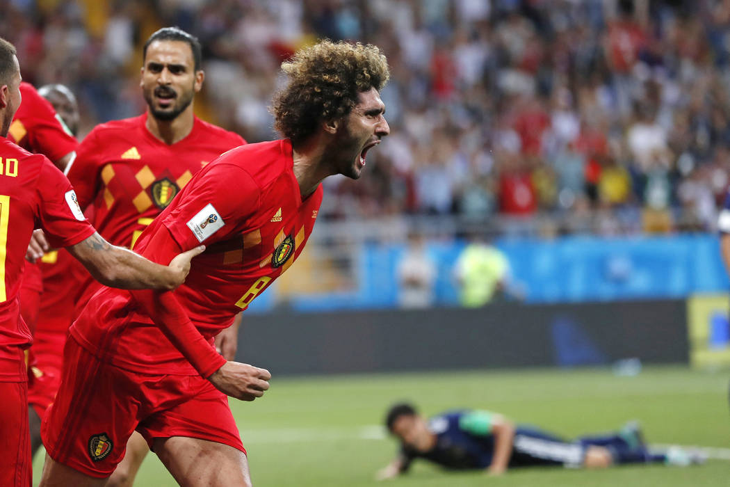 Belgium's Marouane Fellaini celebrates after scoring his side's second goal during the round of 16 match between Belgium and Japan at the 2018 soccer World Cup in the Rostov Arena, in Rostov-on-Do ...