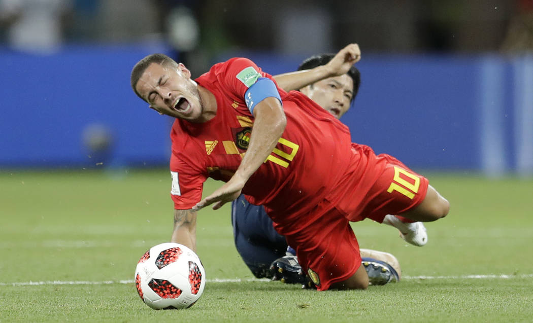 Belgium's Eden Hazard is fouled by Japan's Gaku Shibasaki during the round of 16 match between Belgium and Japan at the 2018 soccer World Cup in the Rostov Arena, in Rostov-on-Don, Russia, Monday, ...